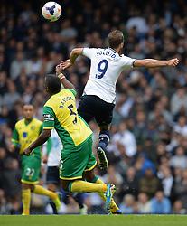 Norwich's Sébastien Bassong and Tottenham's Roberto Soldado compete for the ball  - Photo mandatory by-line: Mitchell Gunn/JMP - Tel: Mobile: 07966 386802 14/09/2013 - SPORT - FOOTBALL -  White Hart Lane - London - Tottenham Hotspur v Norwich - Barclays Premier League
