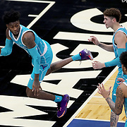 ORLANDO, FL - DECEMBER 17:  Jalen McDaniels #6 of the Charlotte Hornets leaps out of bounds to save the ball as LaMelo Ball #2 of the Charlotte Hornets and PJ Washington #25 of the Charlotte Hornets look on at Amway Center on December 17, 2020 in Orlando, Florida. NOTE TO USER: User expressly acknowledges and agrees that, by downloading and or using this photograph, User is consenting to the terms and conditions of the Getty Images License Agreement. (Photo by Alex Menendez/Getty Images)