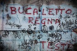 Potenza (PZ), 23-11-2010 ITALY - Il quartiere Bucaletto. Bucaletto è un quartiere popolare della periferia est di Potenza. Fu progettato all'indomani del terremoto dell'Irpinia del 23 novembre 1980, per risolvere i problemi delle famiglie sfollate a causa dei crolli di alcune abitazioni della città, difatti è caratterizzato dalla presenza di abitazioni singole, in prefabbricati..Nella Foto: Scritte sui muri.