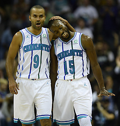 October 17, 2018 - Charlotte, NC, USA - The Charlotte Hornets' Tony Parker (9) hugs teammate Kemba Walker (15) in the second half of their season opener against the Milwaukee Bucks at the Spectrum Center in Charlotte, N.C., on Wednesday, Oct. 17, 2018. The Bucks won, 113-112. (Credit Image: © David T. Foster Iii/Charlotte Observer/TNS via ZUMA Wire)