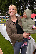 Sarah Cox and Lola. Macmillan Dog Day in aid of Macmillan Cancer Relief. Royal Hospital Chelsea, 5 July 2005. ONE TIME USE ONLY - DO NOT ARCHIVE  © Copyright Photograph by Dafydd Jones 66 Stockwell Park Rd. London SW9 0DA Tel 020 7733 0108 www.dafjones.com