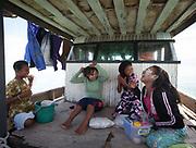Alpaida, Asmania and sisters. Bajau family living all year round on a Lepa, a traditional houseboat. Off Maiga Island.