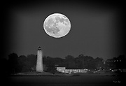 Full Buck Moon rising over Lighthouse and Carousel House in Black & White