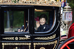 © Licensed to London News Pictures. 05/11/2013. London, United Kingdom.  Park Geun-hye peers out of a carriage during a  State Visit to the UK by President of the Republic of Korea, Park Geun-hye. Photo credit : Andrea Baldo/LNP