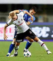 ZHUHAI, July 19, 2017  Yevhen Konoplyanka (R) of FC Schalke 04 vies with Andreas Beck of Besiktas JK during a pre-season soccer match at Zhuhai Sports Center Stadium in Zhuhai, south China's Guangdong Province, July 19, 2017. FC Schalke 04 won 3-2. (Credit Image: © Wang Lili/Xinhua via ZUMA Wire)
