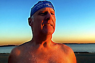 """""""New Year Glow"""" (12/31/01 Boston, MA) Jim Doty, president of the L-street  Brownies, gets ready for the New Years Day traditional swim."""