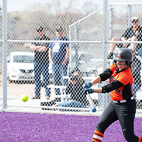 Aztec Tigers third basemen Jocelyn Ulrich (24), at the plate, swings for an RBI double against the Miyamura Patriots. The Tigers won 17-7 in the first game of the double header at Miyamura High School on Friday.