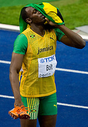 Usain Bolt of Jamaica celebrates winning the gold medal in the men's 200 Metres Final during day six of the 12th IAAF World Athletics Championships at the Olympic Stadium on August 20, 2009 in Berlin, Germany. Bolt set a new World Record of 19.19 seconds. (Photo by Vid Ponikvar / Sportida)