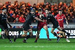 Scarlets' James Davies is tackled by Ospreys' Dan Lydiate and Dan Biggar - Mandatory by-line: Craig Thomas/Replay images - 26/12/2017 - RUGBY - Parc y Scarlets - Llanelli, Wales - Scarlets v Ospreys - Guinness Pro 14