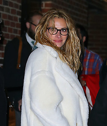December 4 2018, New York City<br /> <br /> Actress Julia Roberts wears bright red Dr. Martens and a fluffy coat as she made an appearance at 'The Late Show' on December 4 2018 in New York City