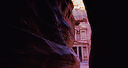 """Approaching through the siq a sliver of  the """"Treasury"""" can be seen at the entrance of Petra, which was recently named one of the """"Seven Modern Wonders of the World"""" - Jordan."""