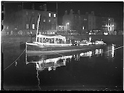 """23/10/1958<br /> 10/23/1958<br /> 23 October 1958<br /> Guinness barge """"Sandyford"""", with band on board, on the river Liffey, Dublin"""