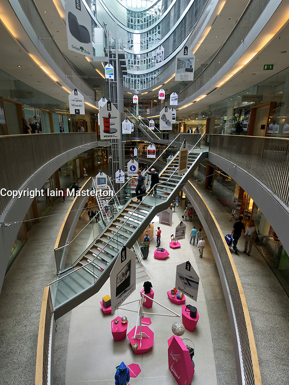 Interior of atrium of modern Stilwerk design shopping mall in Dusseldorf Germany