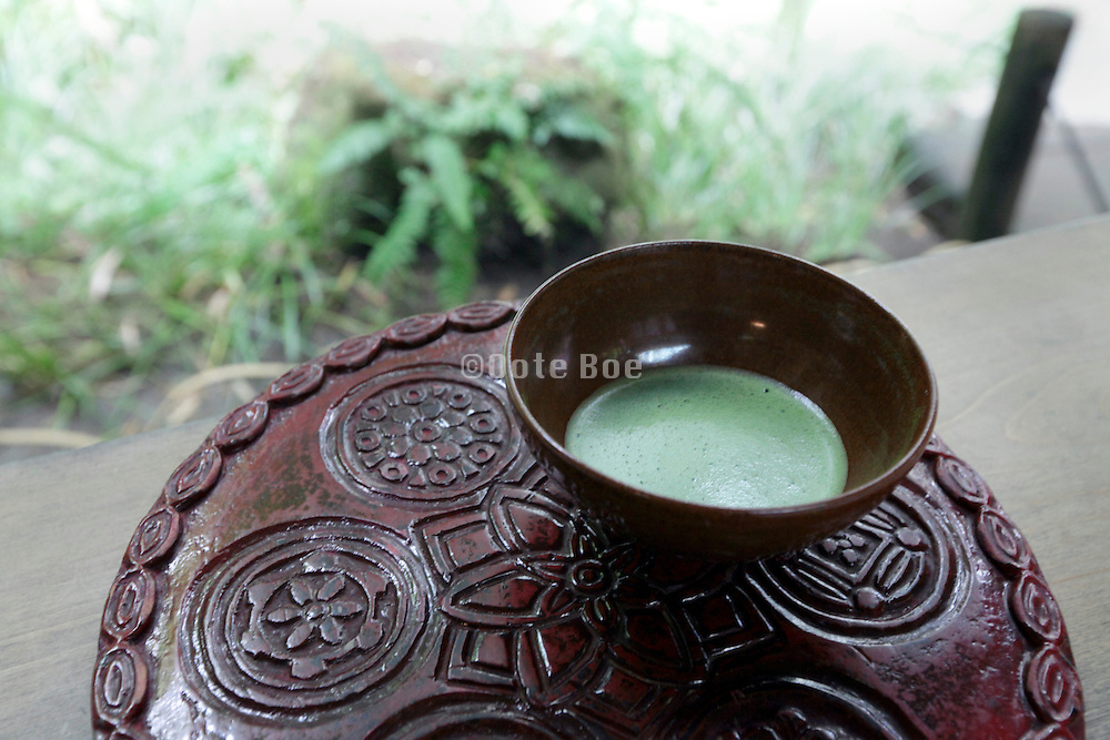 Japanese powder green tea in outdoor setting