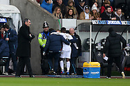Paul Clement, the Swansea city manager (l) watches as Nathan Dyer of Swansea city is helped off with an injury, an injury which sees him out for the rest of the season. Premier league match, Swansea city v Leicester City at the Liberty Stadium in Swansea, South Wales on Sunday 12th February 2017.<br /> pic by Andrew Orchard, Andrew Orchard sports photography.