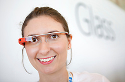 Google employee Sarah Price wears a pair of the Google Project Glass, a wearable personal computer device,  during the Google I/O Developer Conference in San Francisco, California.