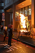 Climate Change activists with Extinction Rebellion set fire to a 'Viking Ship' outside the National Maritime Organisation, a day before the NMO's virtual summit of its Marine Environment Protection Committee, on 15th November 2020, in London, England.