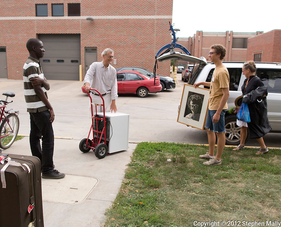 Roommates Reggie Sackey-Addo (left), 17, of Accra, Ghana and Karl Sadkowski (second on right), 18, of Cedar Falls, Iowa unload Sadkowski's belongings with the help of his parents, Konrad Sadkowski (second on left) and Alicja Boruta-Sadkowski (right) both of Cedar Falls, Iowa at Grinnell College in Grinnell, Iowa on Saturday, August 25, 2012.