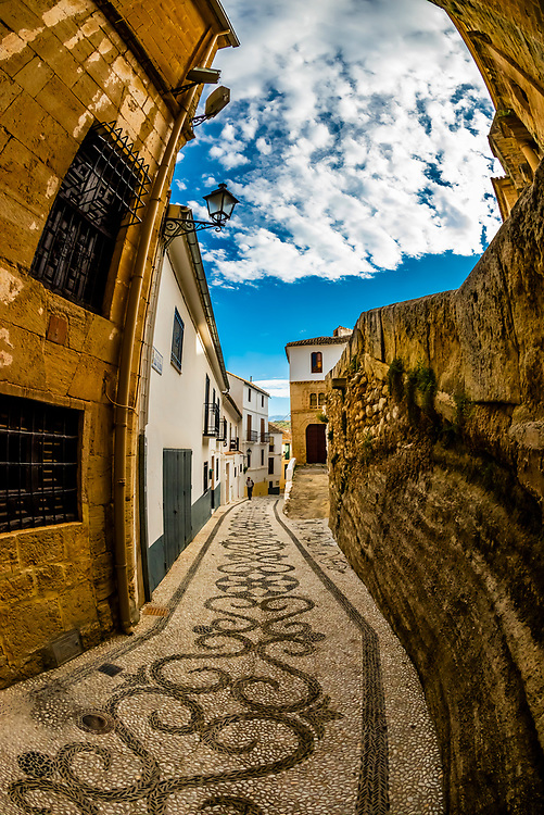 "Intricate stone patterns called ""empedrados"", Calle Baja Iglesia,, Alhama de Granada, Granada Province, Andalusia, Spain."