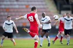 Brora Rangers Grant martin shoots.<br /> half time : Edinburgh City 0 v 0 Brora Rangers, 1st leg, Pyramid Playoffs at Meadowbank, 25/4/2015.