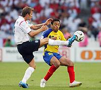 Photo: Chris Ratcliffe.<br /> England v Ecuador. 2nd Round, FIFA World Cup 2006. 25/06/2006.<br /> David Beckham of England clashes with Edwin Tenorio of Ecuador.