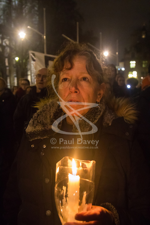 Westminster, London, December 2nd 2015.  As Parliament prepares to vote on air strikes on Islamic State terrorists in Syria, Stop The War and other groups opposed to British military involvement protest outside Parliament. PICTURED: A woman holds a candlelight vigil. ///FOR LICENCING CONTACT: paul@pauldaveycreative.co.uk TEL:+44 (0) 7966 016 296 or +44 (0) 20 8969 6875. ©2015 Paul R Davey. All rights reserved.
