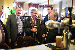 © Licensed to London News Pictures . 25/05/2016 . Bolton , UK . NIGEL FARAGE has a drink in a nearby pub . The UKIP referendum bus tour , campaigning for a UK Brexit , lead by Nigel Farage , in Victoria Square , Bolton . Photo credit : Joel Goodman/LNP