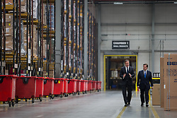 © Licensed to London News Pictures . 02/06/2014 . Newark , Nottinghamshire , UK . David Cameron and Robert Jenrick . The British Prime Minister , David Cameron , in Newark today (Monday 2nd June 2014), ahead of the by-election due to take place on Thursday (5th June 2014) . The PM took questions from staff at the Knowhow Warehouse ( DSG Retail ) and introduced the Conservative candidate for the seat, Robert Jenrick . Photo credit : Joel Goodman/LNP
