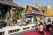 Tourists worship at the Royal Chapel of the Emerald Buddha, Bangkok, Thailand