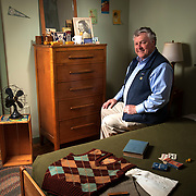 Ray Smith is the Senior Historical Specialist fo the Oak Ridge History Museum in Oak Ridge, Tennessee. Smith is photographed in a recreation of a WWII dorm room at the Oak Ridge facility that helped develop the atomic bomb. Nathan Lambrecht/Journal Communications