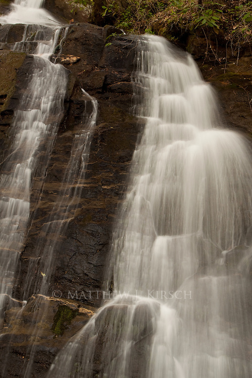 Juney Whank Falls is a 80ft cascade that can be heard well before its seen. There is controversy over its name origin either being traced to person buried near the falls or a translation of a Cherokee Indian phrase.