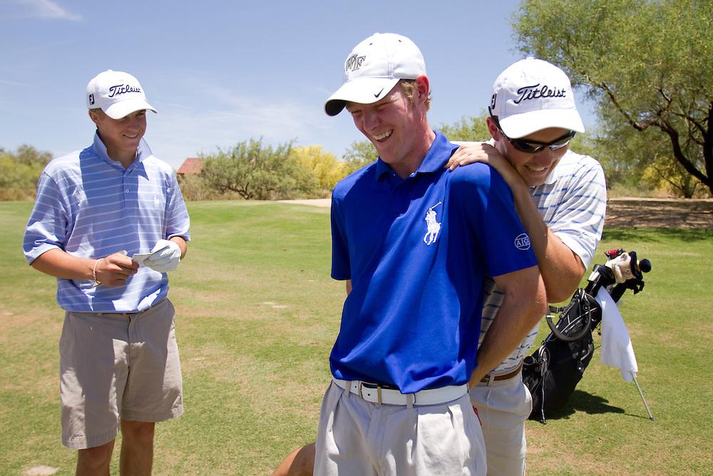 Grayson Murray (dark blue shirt), Andrew Knox (striped shirt) and Billy Kennerly (all white) clown around at the Thunderbird International Junior tournament.