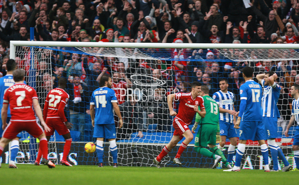 Middlesbrough FC striker Christian Stuani scores goal number three during the Sky Bet Championship match between Brighton and Hove Albion and Middlesbrough at the American Express Community Stadium, Brighton and Hove, England on 19 December 2015. Photo by Bennett Dean.