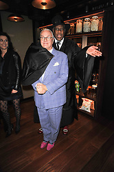 MANOLO BLAHNIK and ANDRE LEON TALLEY at a dinner in honour of Andre Leon Talley and Manolo Blahnik held at The Spice Market restaurant at W London, Leicester Square, London on 14th March 2011.