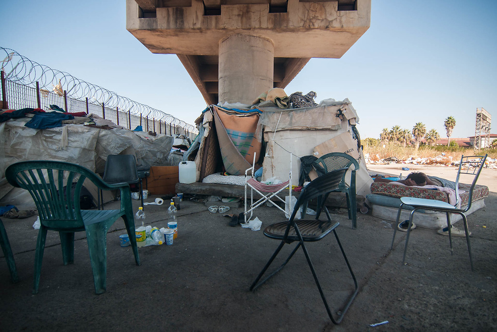 An illegal migrant sleeps in a camp near the railway station on August 03, 2017 in Crotone, Italy. The city of Crotone hosts one of the biggest european centre for migrants, but some of them live in clandestinity, even for two years, in an area near the city railway station, because they are afraid to be rejected and to be sent to their nations again. ©Simone Padovani