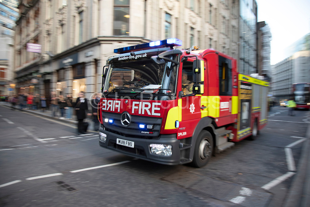 Fire brigade arrive as the City of London is locked down by Metropolitan and City Police following what is believed to have been a terror-related incident on London Bridge at around 2pm on 29th November 2019 in London, United Kingdom. Police officers cordoned off the bridge, underpass and all surrounding roads following the incident during which members of the public intervened before shots were fired by armed police. The incident is said to have started as a stabbing during which a number of people were stabbed in a building near London Bridge.