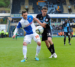 Bristol Rovers' Chris Beardsley holds off Wycombe Wanderers' Dan Rowe - Photo mandatory by-line: Dougie Allward/JMP - Mobile: 07966 386802 26/04/2014 - SPORT - FOOTBALL - High Wycombe - Adams Park - Wycombe Wanderers v Bristol Rovers - Sky Bet League Two