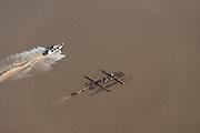 Speed boat & log barge<br /> Essequibo River<br /> GUYANA<br /> South America<br /> Longest river in Guyana