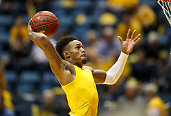 Feb 24, 2018; Morgantown, WV, USA; West Virginia Mountaineers guard Daxter Miles Jr. (4) warms up before their game against the Iowa State Cyclones at WVU Coliseum. Mandatory Credit: Ben Queen-USA TODAY Sports