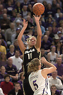 Colorado guard Hannah Skildum (11) shoots and scores over Kansas State guard Shalee Slhning (5) during the first half of K-State's 85-66 win over the Buffaloes at Bramlage Coliseum in Manhattan, Kansas, January 14, 2006.