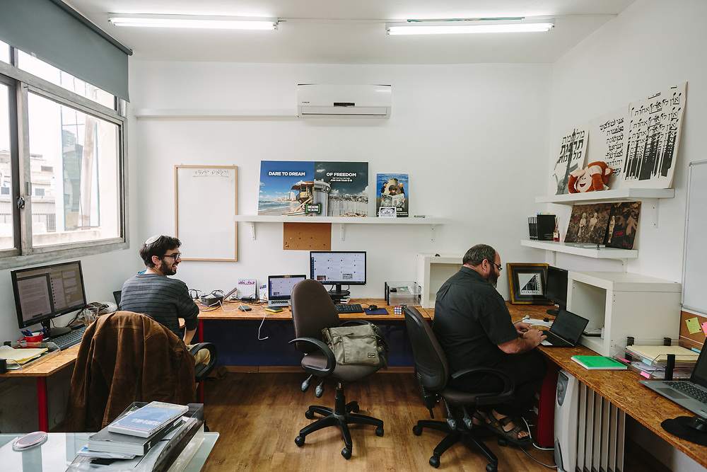 """Yehuda Shaul (R), co-founder and Foreign Relations Director of """"Breaking the Silence"""" and an activist of the organization are seen as they work at the offices of the organization in Ramat Gan, Israel, on February 23, 2020."""