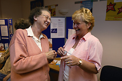 Visitors at an Age Concern stand,