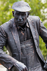 London, July 18th 2015. Human statues in Trafalgar Square -  part of Busk in London aimed at showcasing the outstanding talents of many of the capital's finest street performers, including, musicians, magicians, living statues and bands.