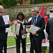 """Norfolk community protest to """"Save the Queen Elizabeth hospital"""" ask to build a new hospital at Old Palace Yard, London, UK on 2021-09-15"""