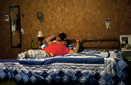 Noel and Marcela Rivera spend quality time together in their bedroom at Titan Farms. The couple met while working at the farm. They have plans of saving their money and opening a general store back home in Hidalgo, Mexico.