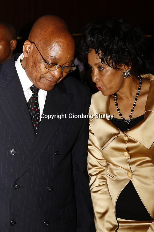 PRETORIA - 16 December 2010 - South African President Jacob Zuma and defence minister Lindiwe Sisulu exchange a few words before the Day of Reconciliation festivities, where Zuma he said that soldiers who can't obey commands, be loyal, disciplined and reliable should not be a part of the Defence Force (SANDF). -- APP/Allied Picture Press