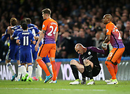 Chelsea's Eden Hazard celebrates scoring his sides second goal as Manchester City's Willy Caballero looks on dejected during the Premier League match at the Stamford Bridge Stadium, London. Picture date: April 5th, 2017. Pic credit should read: David Klein/Sportimage