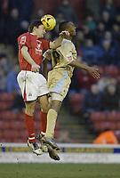 Photo: Aidan Ellis.<br /> Barnsley v Bristol City. Coca Cola League 1. 04/02/2006.<br /> Barnsley's Paul Heckingbottom beats Bristol's Calvin Andrew to the ball