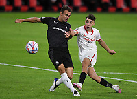 SEVILLE, SPAIN - OCTOBER 28: Munir of FC Sevilla and Damien Da Silva of Stade Rennais during the UEFA Champions League Group E stage match between FC Sevilla and Stade Rennais at Estadio Ramon Sanchez-Pizjuan on October 28, 2020 in Seville, Spain. (Photo by Juan Jose Ubeda/ MB Media).