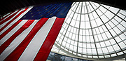 Republican Presidential candidate and Ohio Gov. John Kasich recently held a town hall meeting at Navistar in Lisle, while searching the atrium for angles to photograph the candidate I made this shot of a huge U.S. Flag and the unique concave glass roof of the Lisle office building.